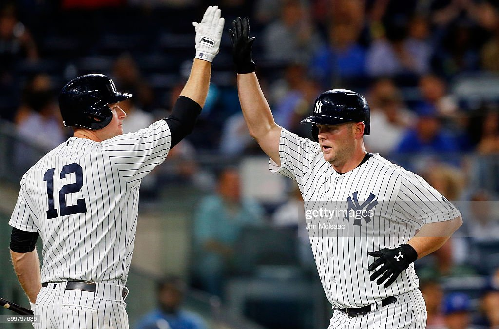 Brian McCann #34 of the New York Yankees celebrates his fourth inning home run against the Toronto Blue Jays with teammate Chase Headley #12 at Yankee Stadium on September 6, 2016 in the Bronx borough of New York City.