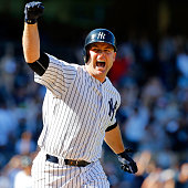 Brian McCann of the New York Yankees celebrates his tenth inning game winning three run home run against the Chicago White Sox at Yankee Stadium on...