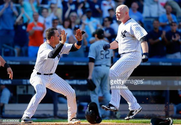 Brian McCann of the New York Yankees celebrates his tenth inning game winning three run home run against Jake Petricka of the Chicago White Sox with...