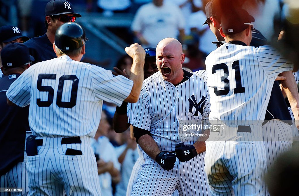 <a gi-track='captionPersonalityLinkClicked' href=/galleries/search?phrase=Brian+McCann+-+Baseball+Player&family=editorial&specificpeople=593065 ng-click='$event.stopPropagation()'>Brian McCann</a> #34 of the New York Yankees celebrates his tenth inning game winning three run home run against the Chicago White Sox at Yankee Stadium on August 24, 2014 in the Bronx borough of New York City. The Yankees defeated the White Sox 7-4 in ten innings.