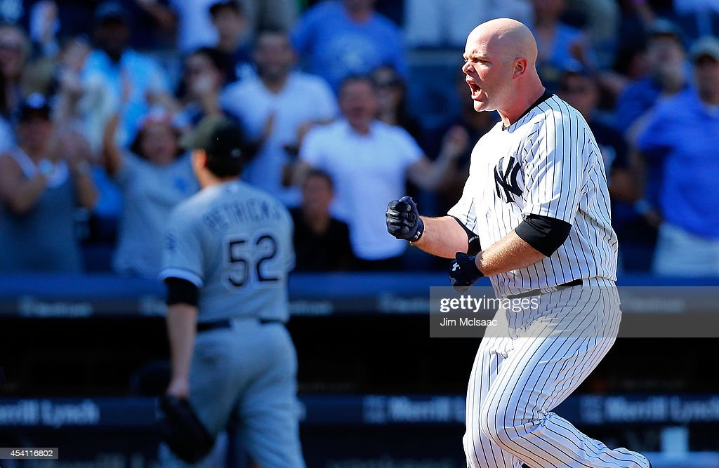 <a gi-track='captionPersonalityLinkClicked' href=/galleries/search?phrase=Brian+McCann+-+Baseball+Player&family=editorial&specificpeople=593065 ng-click='$event.stopPropagation()'>Brian McCann</a> #34 of the New York Yankees celebrates his tenth inning game winning three run home run against <a gi-track='captionPersonalityLinkClicked' href=/galleries/search?phrase=Jake+Petricka&family=editorial&specificpeople=11334070 ng-click='$event.stopPropagation()'>Jake Petricka</a> #52 of the Chicago White Sox at Yankee Stadium on August 24, 2014 in the Bronx borough of New York City. The Yankees defeated the White Sox 7-4 in ten innings.