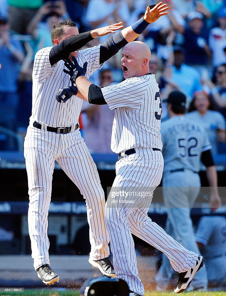 <a gi-track='captionPersonalityLinkClicked' href=/galleries/search?phrase=Brian+McCann+-+Baseball+Player&family=editorial&specificpeople=593065 ng-click='$event.stopPropagation()'>Brian McCann</a> #34 of the New York Yankees celebrates his tenth inning game winning three run home run against <a gi-track='captionPersonalityLinkClicked' href=/galleries/search?phrase=Jake+Petricka&family=editorial&specificpeople=11334070 ng-click='$event.stopPropagation()'>Jake Petricka</a> #52 of the Chicago White Sox with teammate <a gi-track='captionPersonalityLinkClicked' href=/galleries/search?phrase=Martin+Prado&family=editorial&specificpeople=620159 ng-click='$event.stopPropagation()'>Martin Prado</a> #14 at Yankee Stadium on August 24, 2014 in the Bronx borough of New York City. The Yankees defeated the White Sox 7-4 in ten innings.