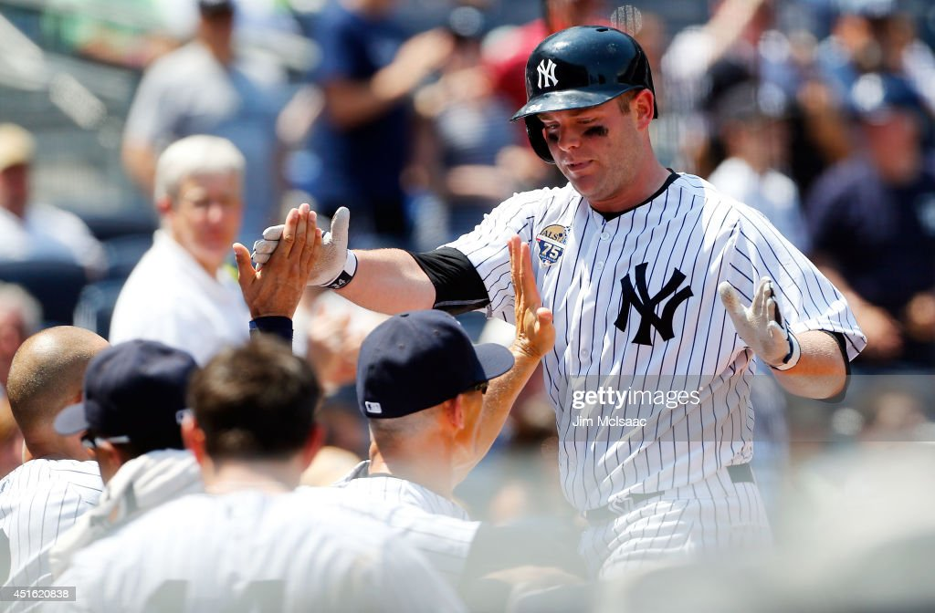 Brian McCann #34 of the New York Yankees celebrates his third inning home run against the Tampa Bay Rays at Yankee Stadium on July 2, 2014 in the Bronx borough of New York City.