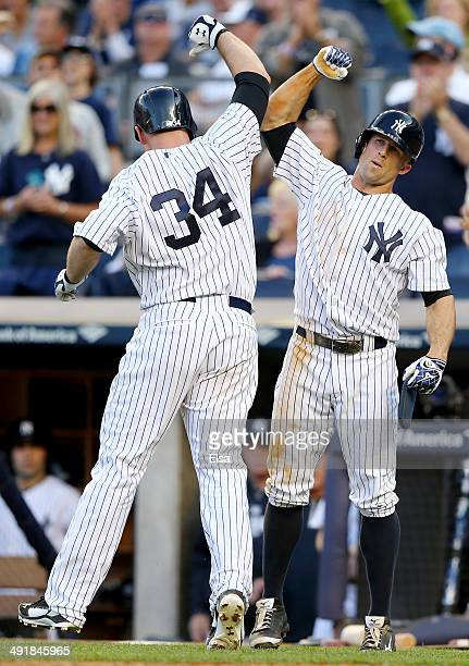 Brian McCann of the New York Yankees celebrates his two run homer with teammate Brett Gardner in the eighth inning against the Pittsburgh Pirates on...