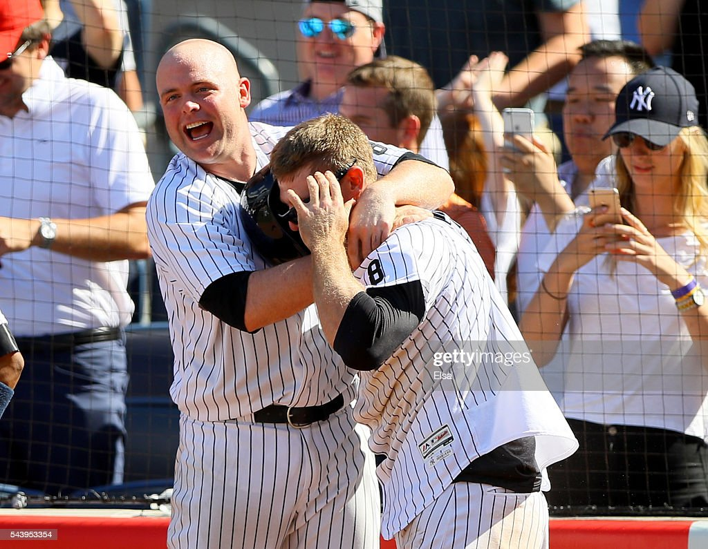 Brian McCann #34 of the New York Yankees congratulates Chase Headley#12 after Headley scored in the bottom of the ninth inning against the Texas Rangers at Yankee Stadium on June 30, 2016 in the Bronx borough of New York City.The New York Yankees defeated the Texas Rangers 2-1.