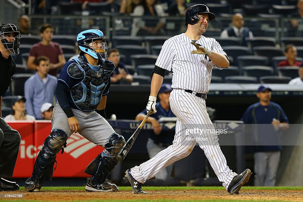 Brian McCann #34 of the New York Yankees connectson a game winning three run home run in the twelfth inning against the Tampa Bay Rays at Yankee Stadium on July 3, 2015 in the Bronx borough of New York City. Yankees defeated the Rays 7-5 in twelfth inning