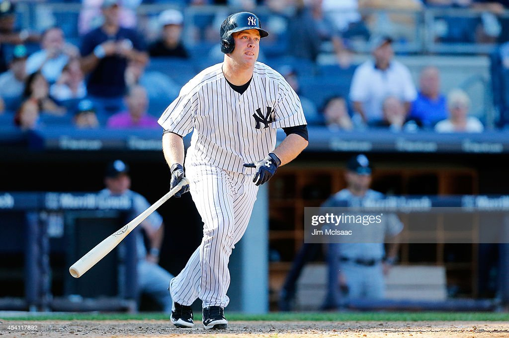 <a gi-track='captionPersonalityLinkClicked' href=/galleries/search?phrase=Brian+McCann+-+Baseball+Player&family=editorial&specificpeople=593065 ng-click='$event.stopPropagation()'>Brian McCann</a> #34 of the New York Yankees follows through on his tenth inning game winning three run home run against the Chicago White Sox at Yankee Stadium on August 24, 2014 in the Bronx borough of New York City. The Yankees defeated the White Sox 7-4 in ten innings.