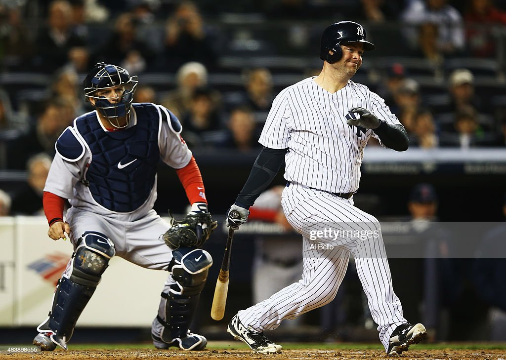 Brian McCann #34 of the New York Yankees hits a double and drives in a run in the fourth inning against the New York Yankees during their game at Yankee Stadium on April 10, 2014 in the Bronx borough of New York City.