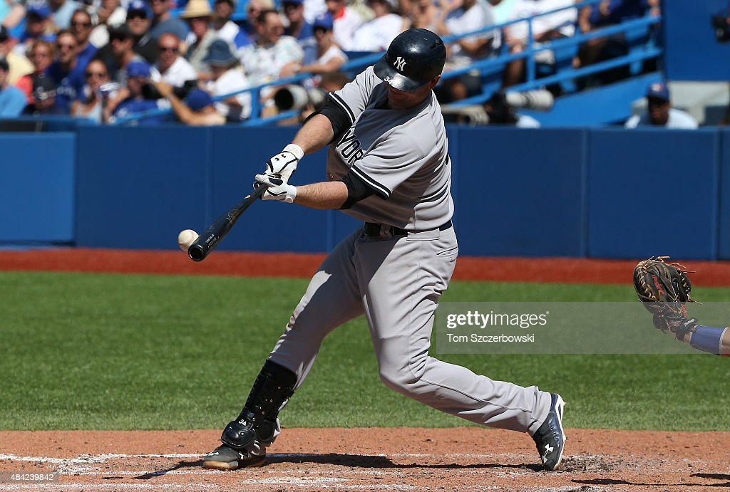 Brian McCann #34 of the New York Yankees hits a double in the seventh inning during MLB game action against the Toronto Blue Jays on August 16, 2015 at Rogers Centre in Toronto, Ontario, Canada.