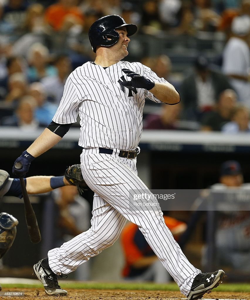 Brian McCann #34 of the New York Yankees hits a home run against the Detroit Tigers during the seventh inning of a MLB baseball game at Yankee Stadium on August 6, 2014 in the Bronx borough of New York City.