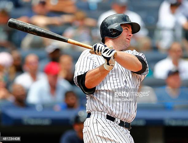 Brian McCann of the New York Yankees hits a two run home run against the Seattle Mariners during the fourth inning of a MLB baseball game at Yankee...
