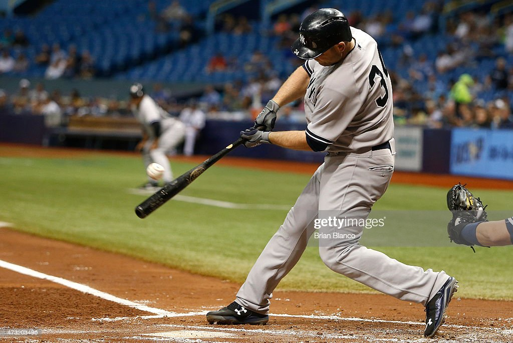 Brian McCann #34 of the New York Yankees hits an RBI single to score Brett Gardner #11 during the first inning of a game against the Tampa Bay Rays on May 13, 2015 at Tropicana Field in St. Petersburg, Florida.