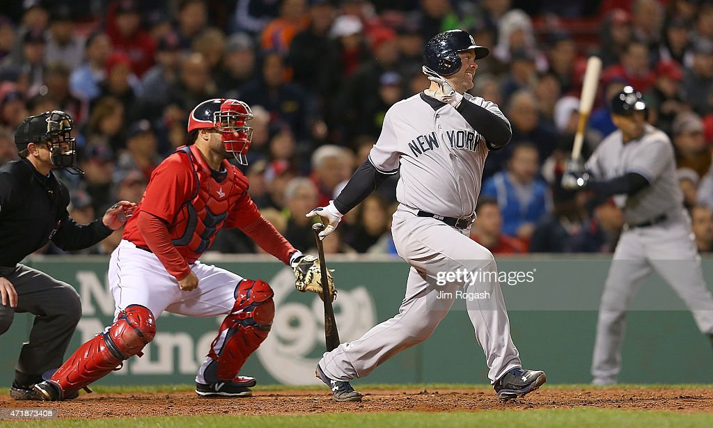 Brian McCann #34 of the New York Yankees knocks in the tying run in the seventh inning as Sandy Leon #3 of the Boston Red Sox defends at Fenway Park May 1, 2015 in Boston, Massachusetts.