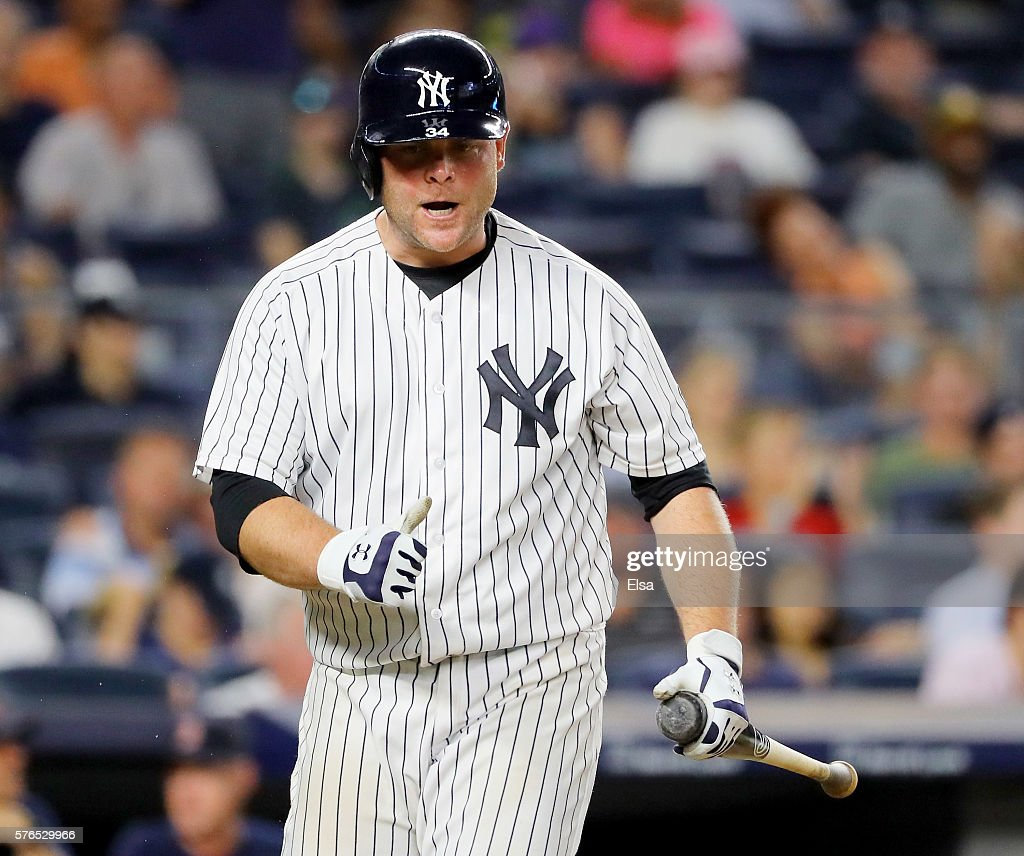 Brian McCann #34 of the New York Yankees reacts after striking out in the ninth inning against the Boston Red Sox at Yankee Stadium on July 15, 2016 in the Bronx borough of New York City.The Boston Red Sox defeated the New York Yankees 5-3.