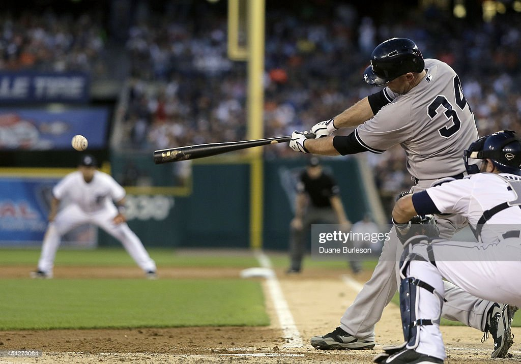 Brian McCann #34 of the New York Yankees singles against the Detroit Tigers during the third inning to drive in Mark Teixeira at Comerica Park on August 27, 2014 in Detroit, Michigan. The Yankees scored eight runs in the third inning and defeated the Tigers 8-4.