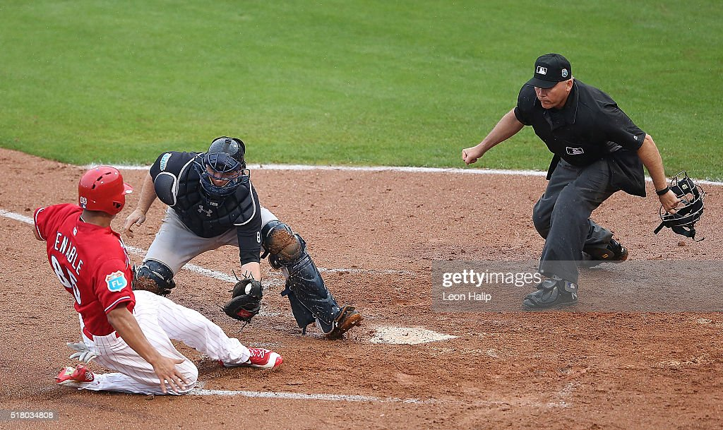Brian McCann of the New York Yankees tags out Will Venable of the Philadelphia Phillies at home plate during the third inning of the Spring Training...