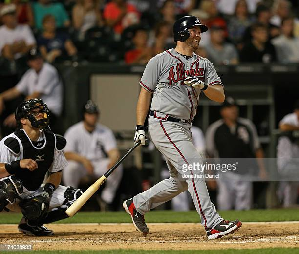 Brian McCann#16 of the Atlanta Braves hits a threerun home run in the 6th inning against the Chicago White Sox at US Cellular Field on July 19 2013...
