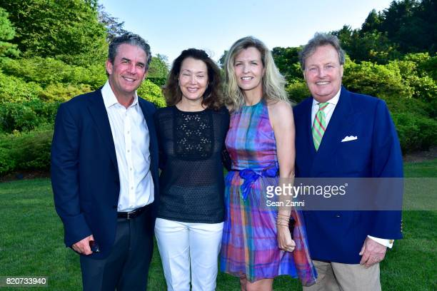 Brian McCarthy Lisa McCarthy Heather Leeds and Tom Leeds attend ARF in the Garden of Peter Marino at a Private Residence on July 15 2017 in...