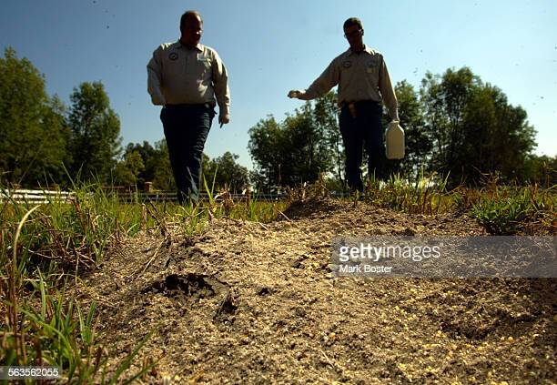 ––Brian McCarty and Chris Cusack with the Orange County Fire Ant Authority treat a horse corral in Coto De Caza Facing the loss of state funds Orange...