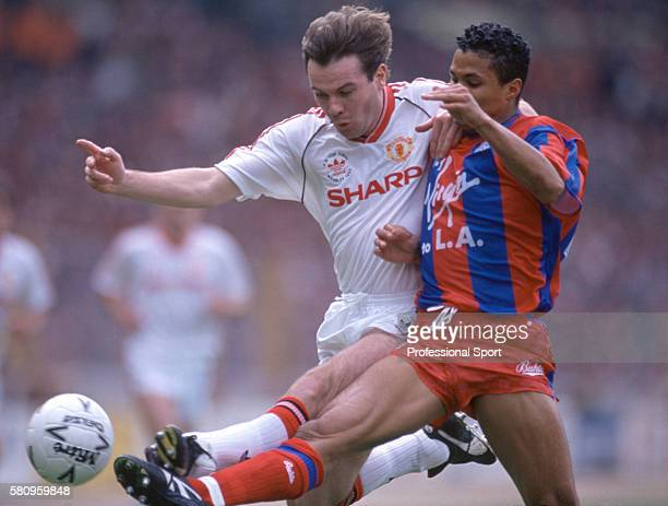 Brian McClair of Manchester United clashes with Crystal Palace striker John Salako during the FA Cup Final between Crystal Palace and Manchester...