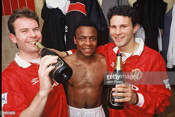 Brian McClair Paul Parker and Ryan Giggs celebrate winning the Fa Carling Premiership in the dressing room following the FA Carling Premiership Match...