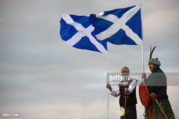 Brian McCutcheon and John Patterson from King of Scots Robert the Bruce Society hold the Scottish flags as they prepare to vote in the Scottish...