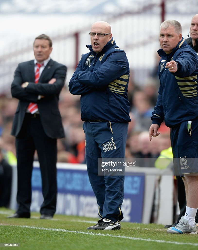 Brian McDermott, Manager of Leeds United shouting his instructions to his players during the Sky Bet Championship match between Barnsley and Leeds United at Oakwell on April 19, 2014 in Barnsley, England,