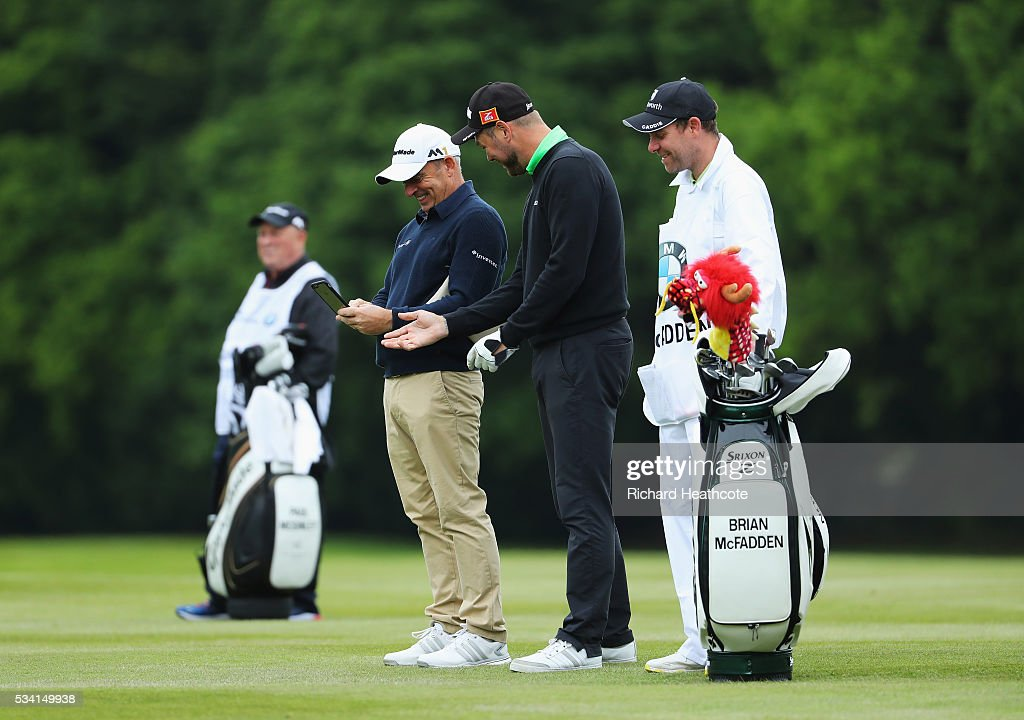 Brian McFadden and <a gi-track='captionPersonalityLinkClicked' href=/galleries/search?phrase=Paul+McGinley&family=editorial&specificpeople=178983 ng-click='$event.stopPropagation()'>Paul McGinley</a> look on during the Pro-Am prior to the BMW PGA Championship at Wentworth on May 25, 2016 in Virginia Water, England.