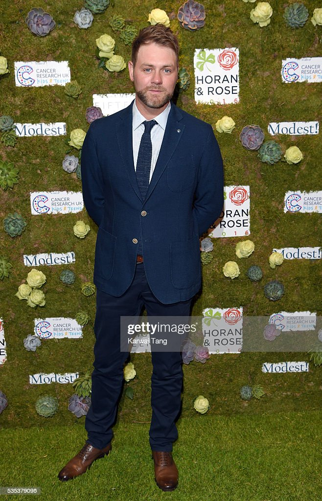 <a gi-track='captionPersonalityLinkClicked' href=/galleries/search?phrase=Brian+McFadden+-+Singer&family=editorial&specificpeople=14999715 ng-click='$event.stopPropagation()'>Brian McFadden</a> arrives for The Horan And Rose event at The Grove on May 29, 2016 in Watford, England.