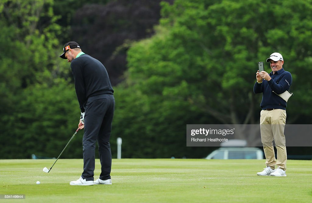 Brian McFadden in action as <a gi-track='captionPersonalityLinkClicked' href=/galleries/search?phrase=Paul+McGinley&family=editorial&specificpeople=178983 ng-click='$event.stopPropagation()'>Paul McGinley</a> of Ireland takes a photo during the Pro-Am prior to the BMW PGA Championship at Wentworth on May 25, 2016 in Virginia Water, England.