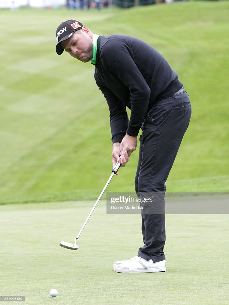 <a gi-track='captionPersonalityLinkClicked' href=/galleries/search?phrase=Brian+McFadden+-+Zanger&family=editorial&specificpeople=14999715 ng-click='$event.stopPropagation()'>Brian McFadden</a> plays during the BMW PGA Celebrity Pro-Am Golf Championship at Wentworth on May 25, 2016 in Virginia Water, England.