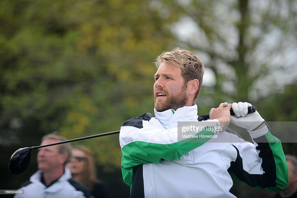 <a gi-track='captionPersonalityLinkClicked' href=/galleries/search?phrase=Brian+McFadden+-+Singer&family=editorial&specificpeople=14999715 ng-click='$event.stopPropagation()'>Brian McFadden</a> tees off at the Celebrity Golf Club Live event at Celtic Manor Resort on May 12, 2013 in Newport, Wales.