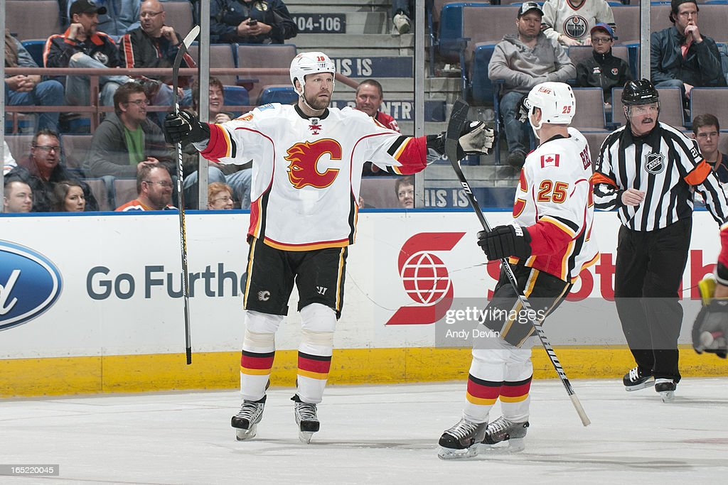 Brian McGrattan #16 and <a gi-track='captionPersonalityLinkClicked' href=/galleries/search?phrase=Steve+Begin&family=editorial&specificpeople=212983 ng-click='$event.stopPropagation()'>Steve Begin</a> #25 of the Calgary Flames celebrate a goal in a game against the Edmonton Oilers on April 1, 2013 at Rexall Place in Edmonton, Alberta, Canada.