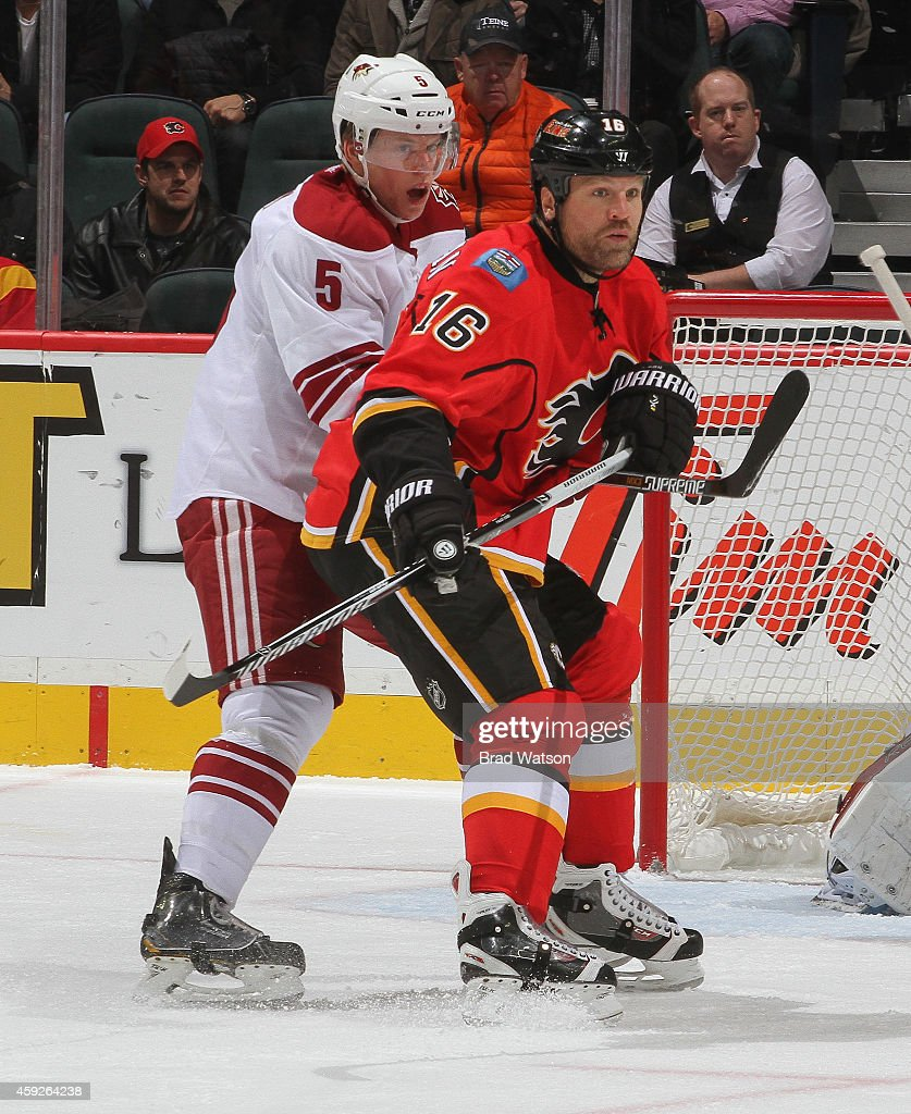Brian McGrattan of the Calgary Flames battles in front of the net against Connor Murphy the Arizona Coyotes at Scotiabank Saddledome on November 13...
