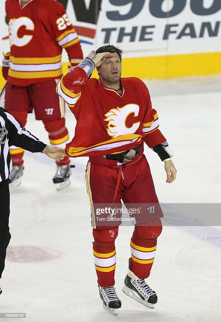 Brian McGrattan of the Calgary Flames celebrates after fighting Tom Sestito of the Vancouver Canucks during their NHL game at the Scotiabank...