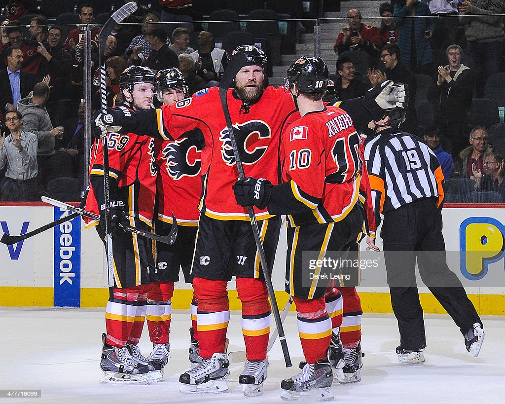 <a gi-track='captionPersonalityLinkClicked' href=/galleries/search?phrase=Brian+McGrattan&family=editorial&specificpeople=598177 ng-click='$event.stopPropagation()'>Brian McGrattan</a> #16 of the Calgary Flames celebrates with <a gi-track='captionPersonalityLinkClicked' href=/galleries/search?phrase=Corban+Knight&family=editorial&specificpeople=5944763 ng-click='$event.stopPropagation()'>Corban Knight</a> #10 after scoring against the Los Angeles Kings during an NHL game at Scotiabank Saddledome on March 10, 2014 in Calgary, Alberta, Canada. The Kings defeated the Flames 3-2.