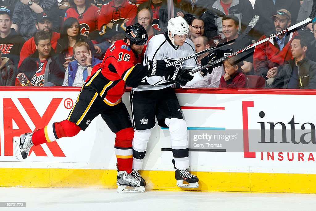 <a gi-track='captionPersonalityLinkClicked' href=/galleries/search?phrase=Brian+McGrattan&family=editorial&specificpeople=598177 ng-click='$event.stopPropagation()'>Brian McGrattan</a> #16 of the Calgary Flames checks <a gi-track='captionPersonalityLinkClicked' href=/galleries/search?phrase=Andrew+Campbell&family=editorial&specificpeople=1689074 ng-click='$event.stopPropagation()'>Andrew Campbell</a> #81 of the Los Angeles Kings at Scotiabank Saddledome on April 9, 2014 in Calgary, Alberta, Canada.
