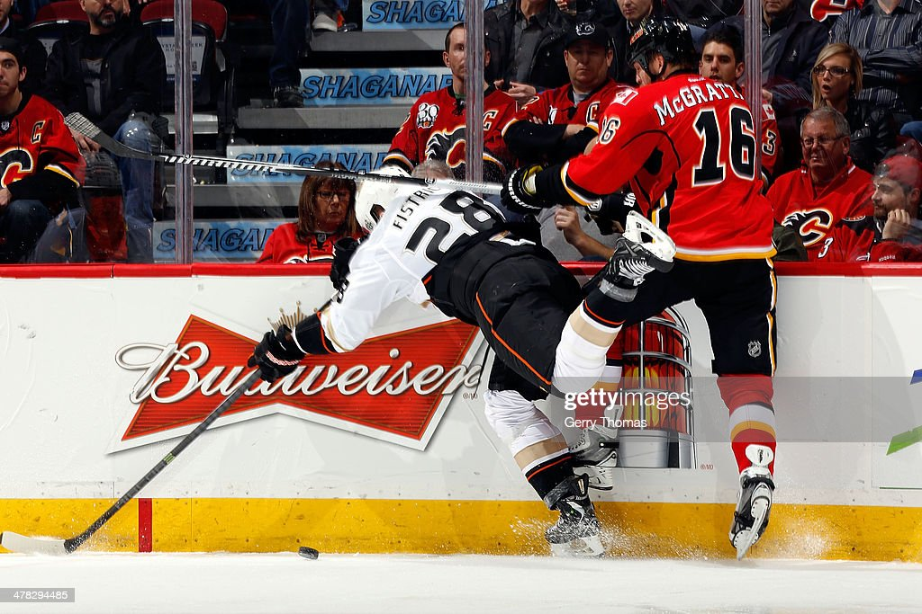 <a gi-track='captionPersonalityLinkClicked' href=/galleries/search?phrase=Brian+McGrattan&family=editorial&specificpeople=598177 ng-click='$event.stopPropagation()'>Brian McGrattan</a> #16 of the Calgary Flames checks <a gi-track='captionPersonalityLinkClicked' href=/galleries/search?phrase=Mark+Fistric&family=editorial&specificpeople=2129692 ng-click='$event.stopPropagation()'>Mark Fistric</a> #28 of the Anaheim Ducks at Scotiabank Saddledome on March 12, 2014 in Calgary, Alberta, Canada.