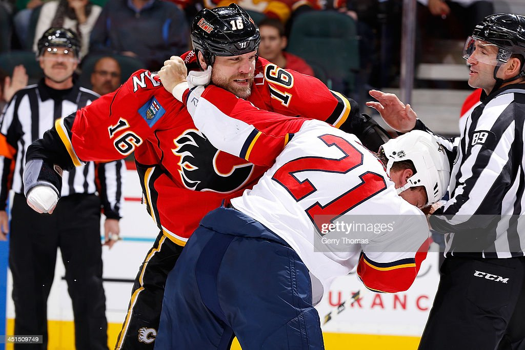 <a gi-track='captionPersonalityLinkClicked' href=/galleries/search?phrase=Brian+McGrattan&family=editorial&specificpeople=598177 ng-click='$event.stopPropagation()'>Brian McGrattan</a> #16 of the Calgary Flames fights <a gi-track='captionPersonalityLinkClicked' href=/galleries/search?phrase=Krys+Barch&family=editorial&specificpeople=2538220 ng-click='$event.stopPropagation()'>Krys Barch</a> #21 of the Florida Panthers at Scotiabank Saddledome on November 22, 2013 in Calgary, Alberta, Canada.