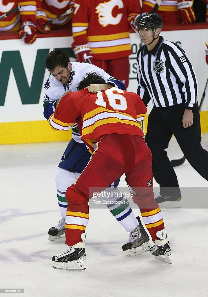 Brian McGrattan of the Calgary Flames fights Tom Sestito of the Vancouver Canucks during their NHL game at the Scotiabank Saddledome on March 3 2013...