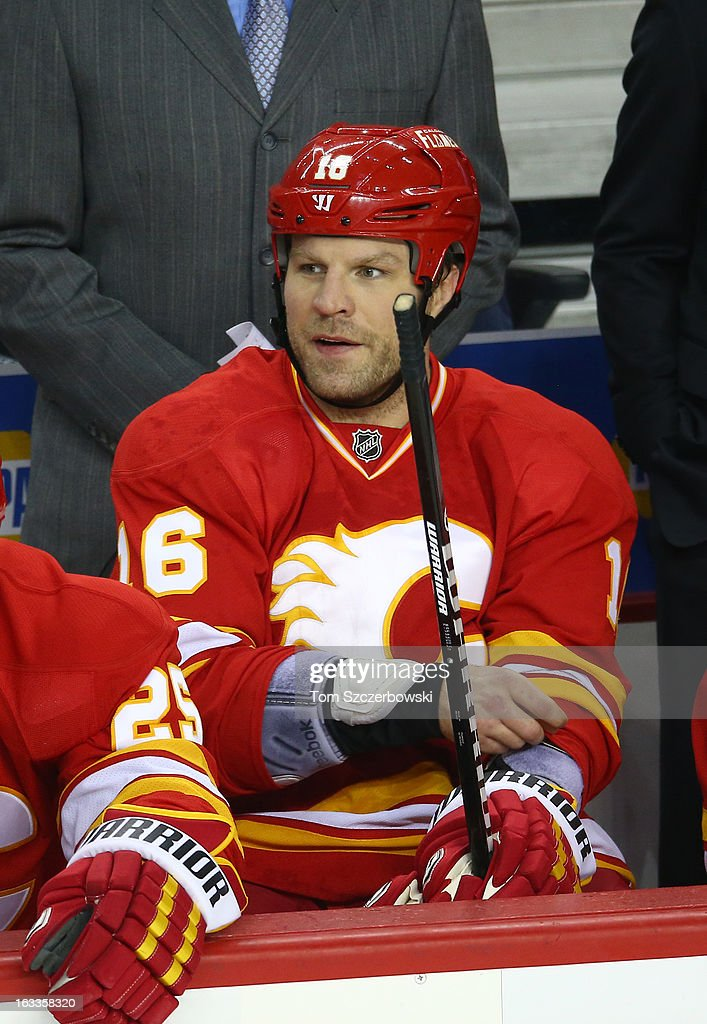 Brian McGrattan of the Calgary Flames looks on from the bench during their NHL game against the Vancouver Canucks at the Scotiabank Saddledome on...