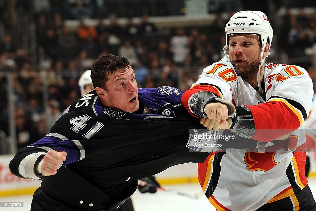 Brian McGrattan of the Calgary Flames punches Raitis Ivanans of the Los Angeles Kings during the game on December 7 2009 at Staples Center in Los...