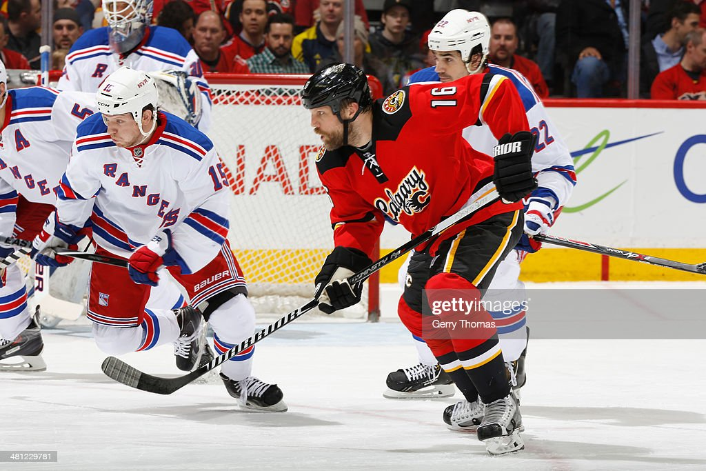 Brian McGrattan #16 of the Calgary Flames skates against Derek Dorsett #15 of the New York Rangers at Scotiabank Saddledome on March 28, 2014 in Calgary, Alberta, Canada.