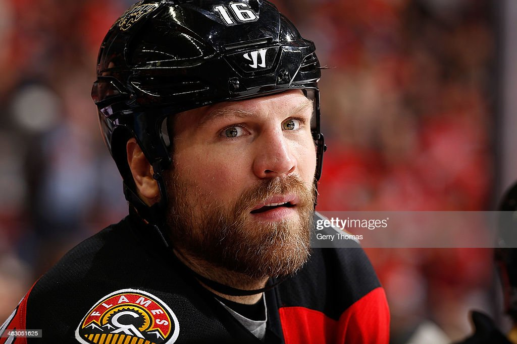 Brian McGrattan of the Calgary Flames skates against the Edmonton Oilers at Scotiabank Saddledome on December 27 2013 in Calgary Alberta Canada The...
