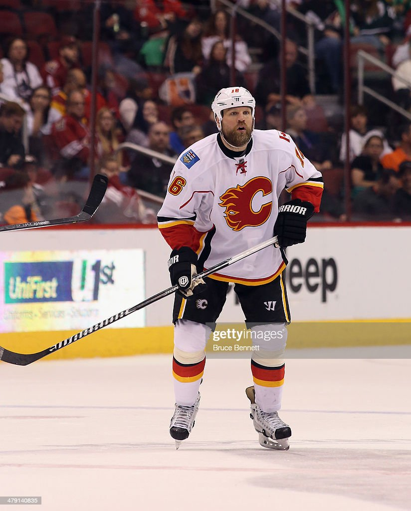 Brian McGrattan of the Calgary Flames skates against the Phoenix Coyotes at the Jobingcom Arena on March 15 2014 in Glendale Arizona The Coyotes...