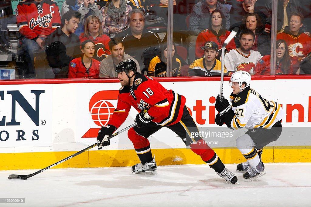 Brian McGrattan of the Calgary Flames skates against Torey Krug of the Boston Bruins at Scotiabank Saddledome on December 10 2013 in Calgary Alberta...