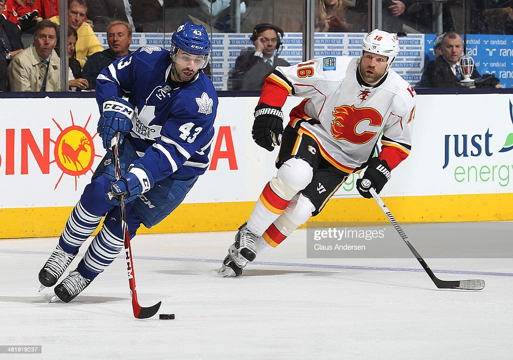 Brian McGratton #16 of the Calgary Flames skates to check Nazem Kadri #43 of the Toronto Maple Leafs during an NHL game at the Air Canada Centre on April 1, 2014 in Toronto, Ontario, Canada. The Leafs defeated the Flames 3-2.