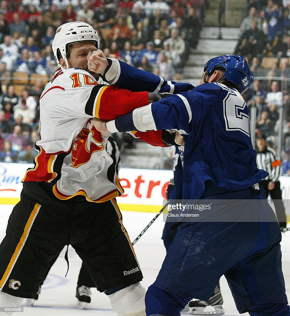 Brian McGratton #10 of the Calgary Flames takes a big punch off the nose from <a gi-track='captionPersonalityLinkClicked' href=/galleries/search?phrase=Colton+Orr&family=editorial&specificpeople=581689 ng-click='$event.stopPropagation()'>Colton Orr</a> #28 of the Toronto Maple Leafs on November 14, 2009 at the Air Canada Centre in Toronto, Ontario, Canada.