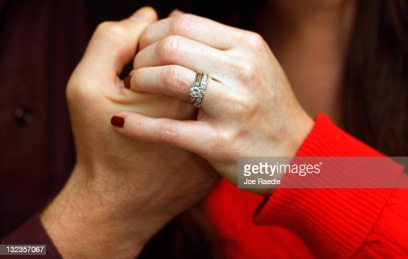Brian McGuinn holds hands with his wife Anne McGuinn wearing her 15carat diamond engagement ring on November 11 2011 in Margate Florida Brian says...