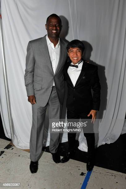 Brian McKnight and Arnel Pineda attend the wedding of Michaele Schon and Neal Schon at the Palace of Fine Arts on December 15 2013 in San Francisco...